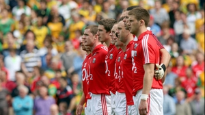 The Cork team stand for the national anthem