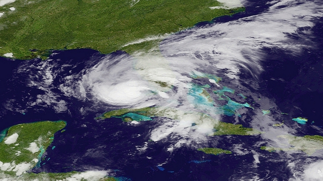 A satellite image from the National Oceanic and Atmospheric Administration shows Isaac moving across Florida