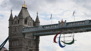 The Agitos Symbol of The Paralympics is suspended from Tower Bridge
