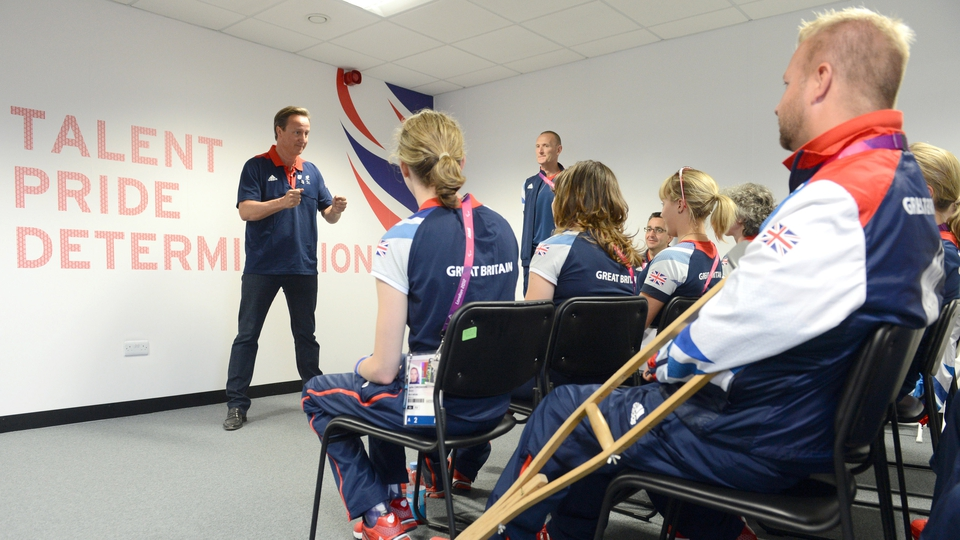 British PM David Cameron speaks to members of the GB Paralympics equestrian team during a visit to the Olympic village last week