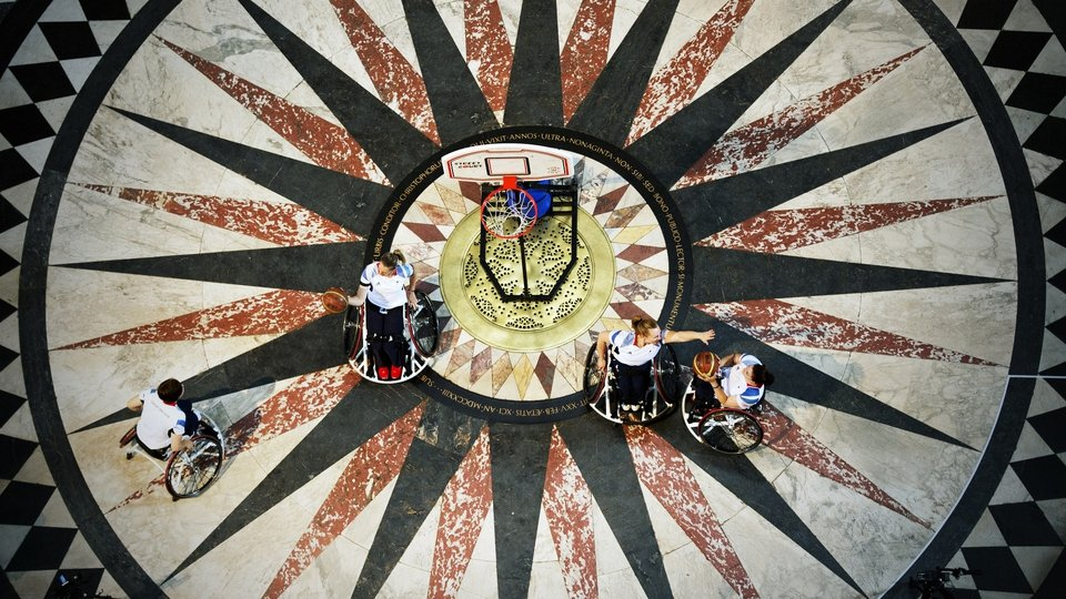 Paralympians Sarah Grady, Judith Hamer, Helen Turner and Louise Sugden practice shooting baskets under the dome of St Paul's Cathedral