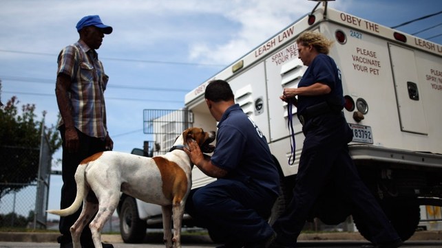 Wilbert Williams watches as his dog Spot is taken temporarily by animal control as he heads to the hurricane shelter at the Belle Chasse Auditorium