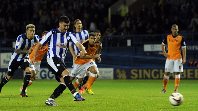 Gary Madine of Sheffield Wednesday scores the penalty that beat Fulham
