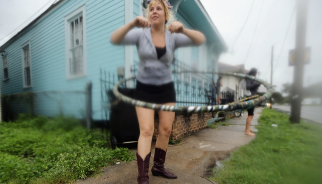 Kat Soulagnet hula hoops at a 'Hurricane Party' in the Upper Ninth Ward in New Orleans