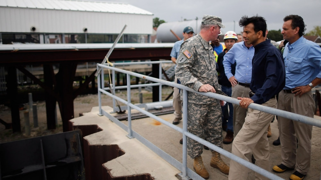 Louisiana Governor Bobby Jindal receives an update on the status of the pumping station at the 17th Street Canal