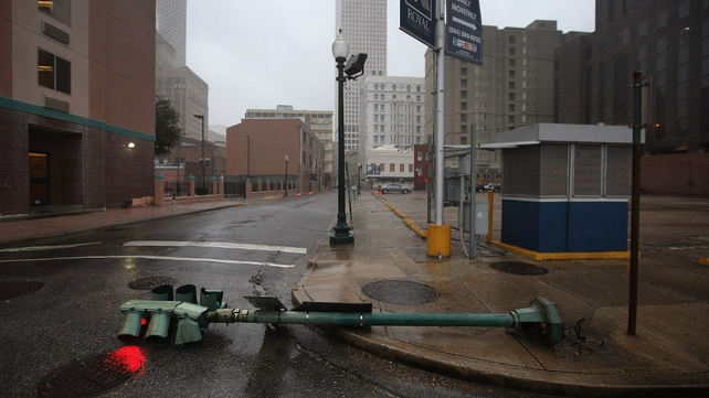 A traffic light glows red after being downed hurricane winds in New Orleans