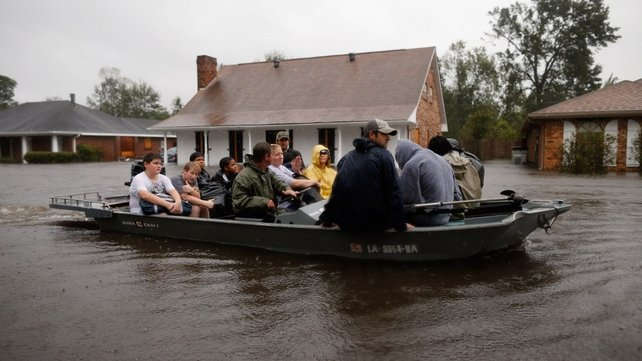 Rescue workers transport residents trapped by rising water from Hurricane Isaac in LaPlace, Louisiana