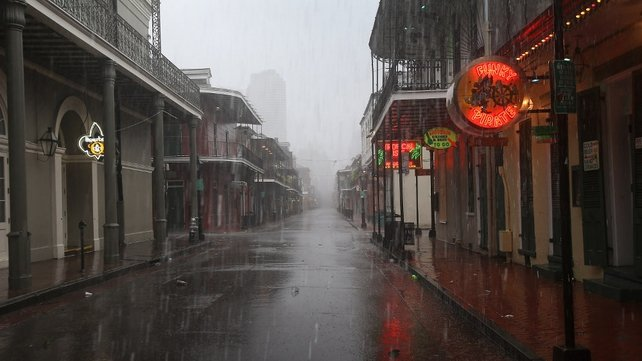 Rain from Hurricane Isaac falls over Bourbon Street in New Orleans