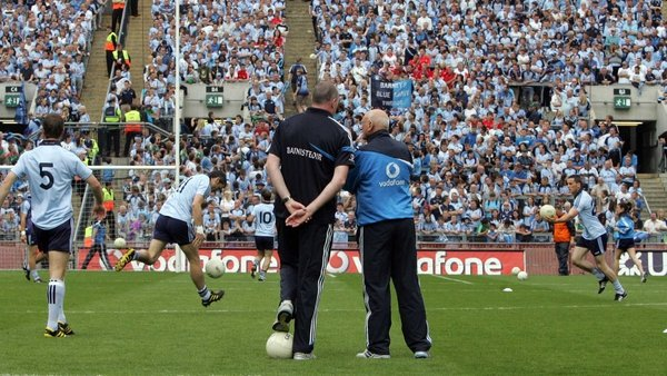 Manager Pat Gilroy (L) and coach Mickey Whelan look on as Dublin warm up in front of Hill 16