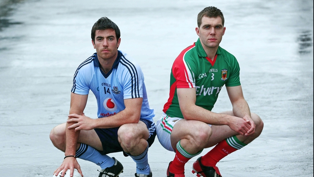Dublin's Michael Darragh MacAuley and Mayo's Seamus O'Shea