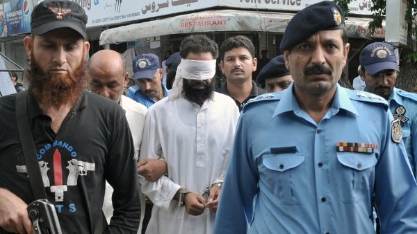 Khalid Chishti was blindfolded as he was brought to court in Islamabad