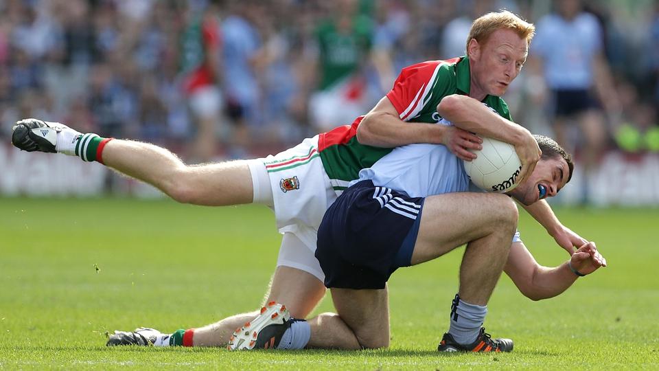 Dublin's Ger Brennan is put under pressure by Richie Feeney