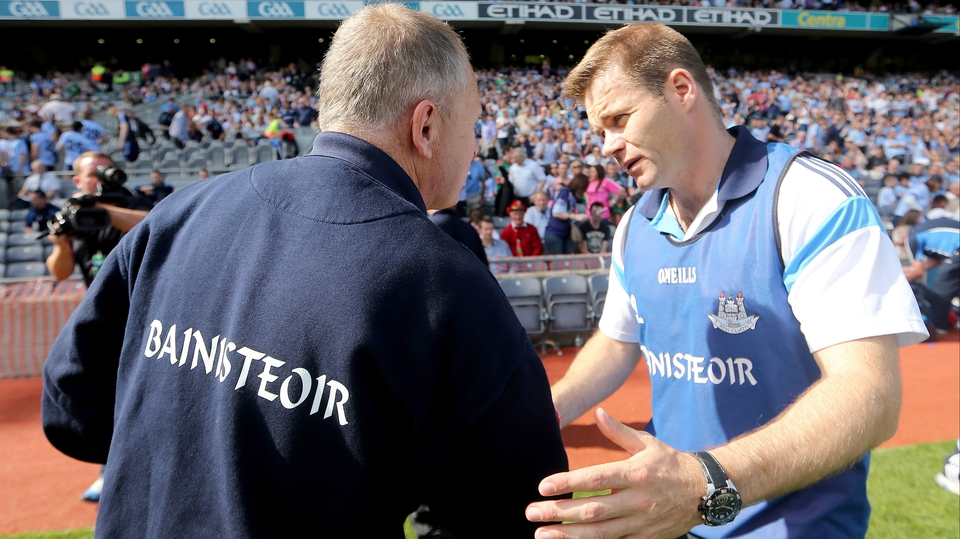 Kerry's manager Mickey Ned O'Sullivan (l) and Dublin manager Dessie Farrell shake hands at the final whistle after Dublin's 3-12 to 1-10 success