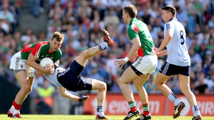 Mayo's Aidan O'Shea (l) and Denis Bastick of Dublin wrestle for possession as Eamon Fennell (r) and Barry Moran look on