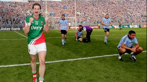 Mayo's Michael Conroy celebrated at the final whistle, as Dublin players and Hill 16 mourned