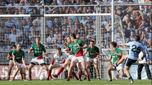 Dublin's Kevin McManamon attempts a shot on goal during the final moments of the match
