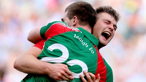 Brothers Seamus and Aidan O'Shea embrace at the end of the game