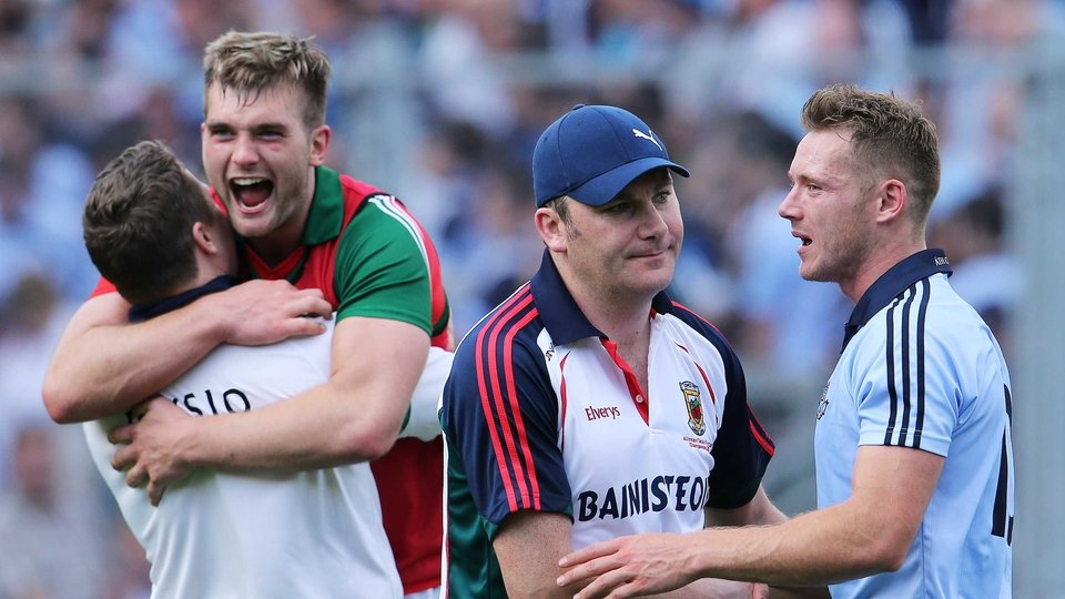 Mayo manager James Horan commiserates with Dublin's Paul Flynn