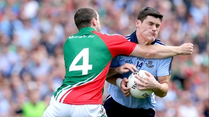 Mayo's Keith Higgins is determined to prevent Diarmuid Connolly from progressing