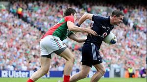 Alan Freeman gets to grips with Dublin goalkeeper Stephen Cluxton