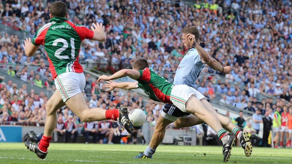 Dublin's Paul Flynn gets his shot away despite the best efforts of Lee Keegan