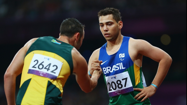 Alan Fonteles Cardoso Oliveira of Brazil is congratulated by Oscar Pistorius of South Africa