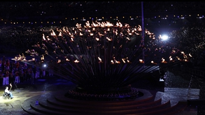 British former Paralympian Margaret Maughan lights the cauldron bearing the Paralympic flame at the opening ceremony