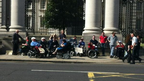 People with disabilities protesting outside Government Buildings in September