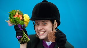 Kearney poses for the cameras with her bronze medal