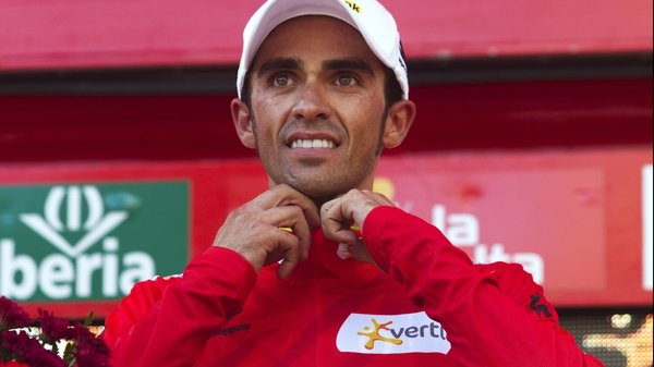 Alberto Contador dons the leader's red jersey at the Vuelta a Espana