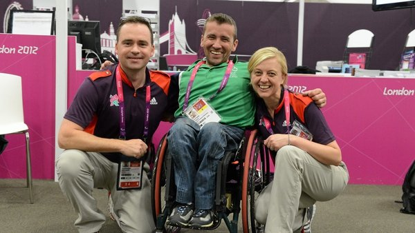 John Fulham poses with London 2012 volunteers