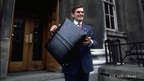 Ray MacSharry holding budget briefcase (1987)   © RTÉ Stills Library 0713/055