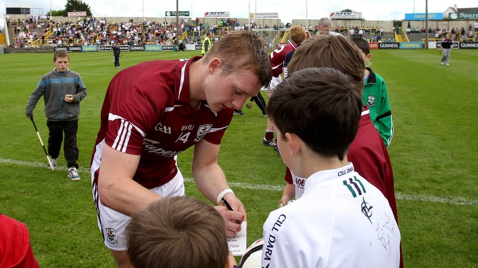 Joe Canning signing autographs after the final whistle