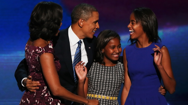 Mr Obama was joined on stage by his family