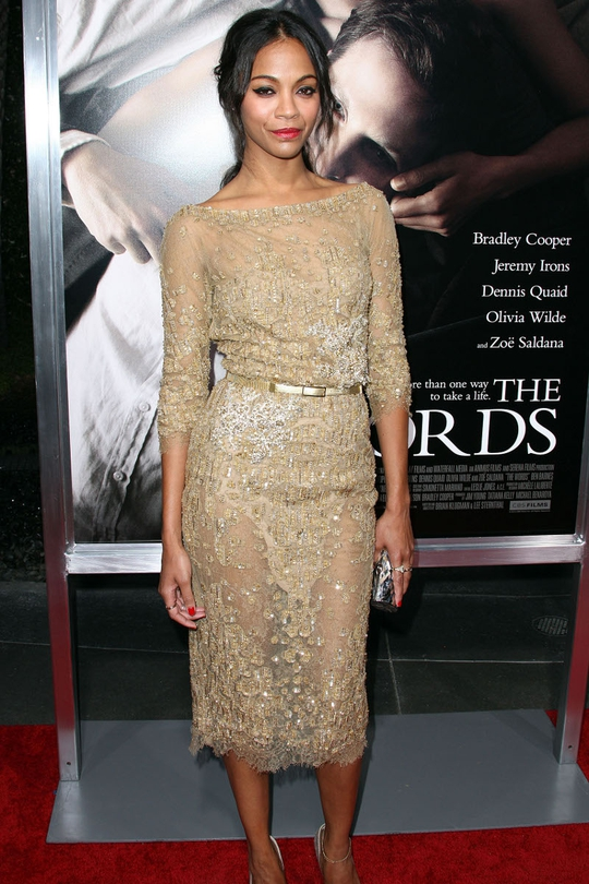 Zoe Saldana looks a million dollars in this Elie Saab couture dress. The mid-length sleeves really suit her long, slender frame, while the golden belt cinches and accentuates her already-tiny waist. Dazzlingly gorgeous!