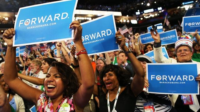 Democratic supporters cheer Mr Obama's speech