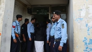 Pakistani policemen stand guard outside a court during the case hearing of a Christian girl accused of blasphemy