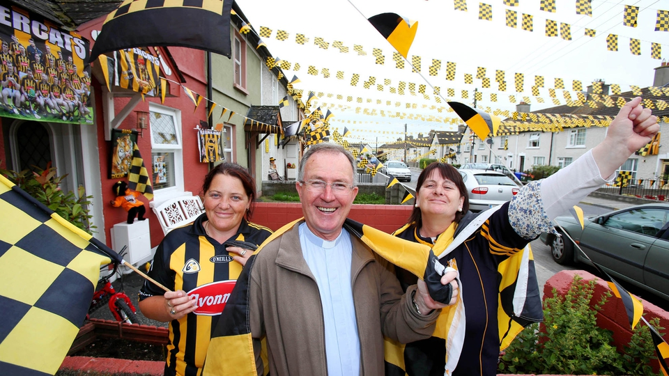 Veronica Maher, Anne Duggan and Fr Jim Murphy flying the flag for the Cats