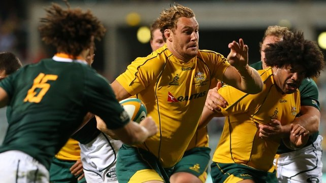 Scott Higginbotham pushes through the Springbok defence to score Australia's first try