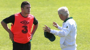 Robbie Brady receives instructions from Giovanni Trapattoni at training in London