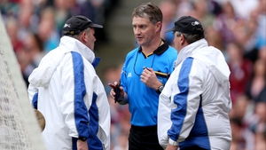 Referee Barry Kelly speaks to his umpires about a second-half shot by Richie Power of Kilkenny