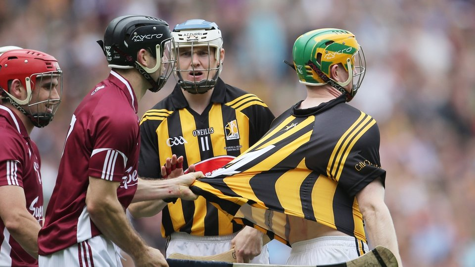 Galway's David Collins holds onto the jersey of Kilkenny's Richie Power