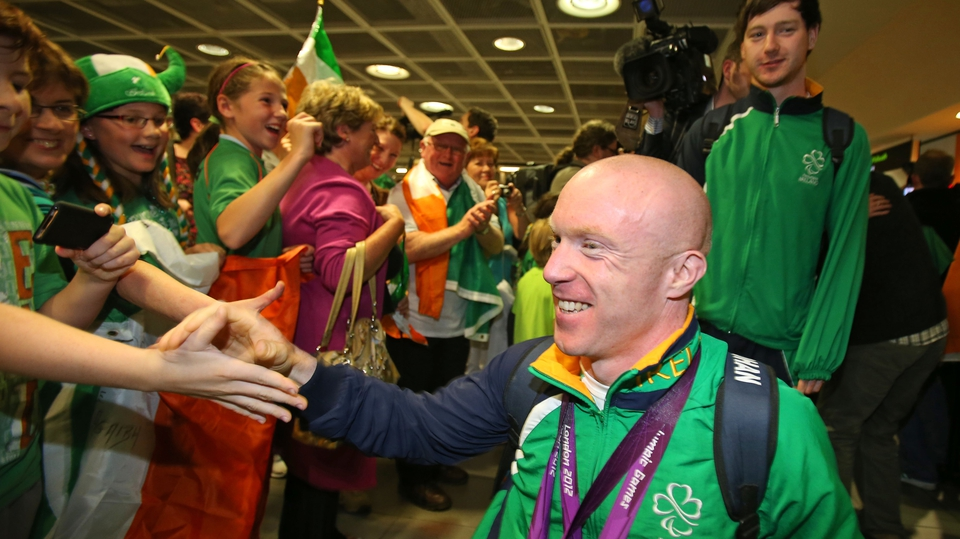 Double gold medalist Mark Rohan is greeted home by adoring fans.