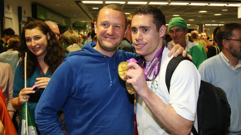 Comedian PJ Gallagher with sprinter Jason Smyth.