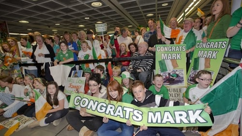 A huge crowd awaits the return of the successful Irish Paralympic team.