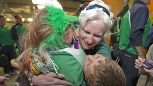 Cyclist Catherine Walsh is welcomed home by her children.