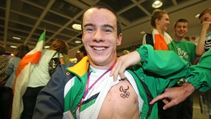 Swimmer James Scully shows off his paralymic logo tattoo.