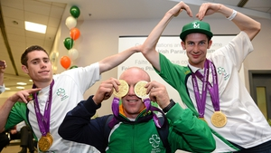 Jason Smyth, Mark Rohan and Michael McKillop show off their medals as the Irish team returns to Dublin