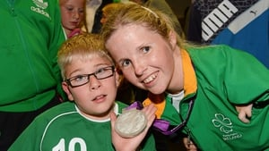 Catherine O'Neill, who won a silver medal in the discus throw -T51 with Shane Barker, age 9, from Donabate, Co Dublin.