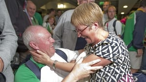 Michael Cunningham, coach with the team, is congratulated by Una McArdle.